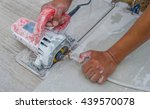 man cutting a ceramic floor... | Shutterstock . vector #439570078