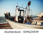 fishing boat is abandoned next... | Shutterstock . vector #439624549