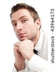 Portrait of young businessman who is upset and sad. Close up isolated on white - stock photo