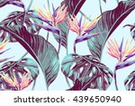 Stock vector tropical flowers jungle leaves bird of paradise flower beautiful seamless vector floral pattern 439650940