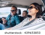 happy family riding in a car | Shutterstock . vector #439653853
