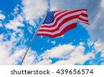 american flag on blue sky | Shutterstock . vector #439656574