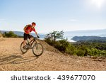 mountain biker riding on bike... | Shutterstock . vector #439677070