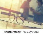glasses on office desk and... | Shutterstock . vector #439693903