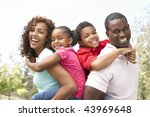 portrait of happy family in park | Shutterstock . vector #43969648