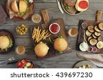 different burgers and beer on... | Shutterstock . vector #439697230