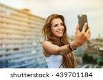 happy young woman taking selfie ... | Shutterstock . vector #439701184