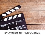 photo of movie clapper on wood | Shutterstock . vector #439705528