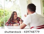 young man and woman are sitting ... | Shutterstock . vector #439748779