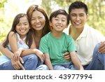 family enjoying day in park | Shutterstock . vector #43977994