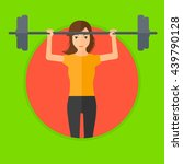 sporty woman lifting a heavy... | Shutterstock .eps vector #439790128