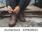 tying shoes on wooden floor ... | Shutterstock . vector #439828024