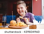 funny little boy eating a... | Shutterstock . vector #439834960