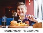 funny little boy eating a... | Shutterstock . vector #439835098