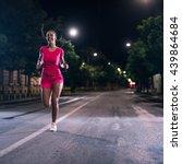 woman running outdoors on the... | Shutterstock . vector #439864684