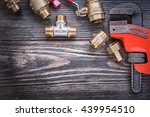 set of plumbers tools on wooden ... | Shutterstock . vector #439954510