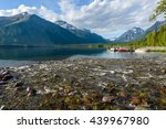 Lake McDonald - A spring evening view of Lake McDonald at outlet of Snyder Creek. Glacier National Park, Montana, USA. - stock photo
