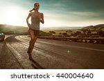 woman runner at sunset | Shutterstock . vector #440004640