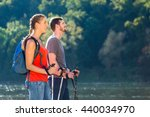 couple hiking or nordic walking ... | Shutterstock . vector #440034970