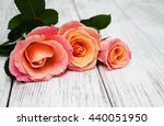 three pink roses on a old white ... | Shutterstock . vector #440051950