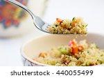 Stock photo quinoa salad close up in a white bowl 440055499