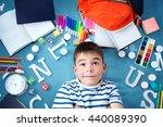 child lying on blue blanket... | Shutterstock . vector #440089390