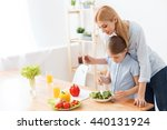 mother and daughter making salad | Shutterstock . vector #440131924