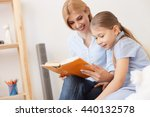 mother and daughter reading... | Shutterstock . vector #440132578