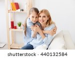 mother playing with her... | Shutterstock . vector #440132584