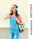 portrait happy woman listens to ... | Shutterstock . vector #440172670