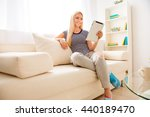 young smiling woman having rest ... | Shutterstock . vector #440189470