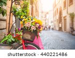 Bicycle With Flowers In The Ol...