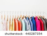 different clothes on the rack | Shutterstock . vector #440287354
