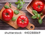 big tomatoes with basil top view | Shutterstock . vector #440288869