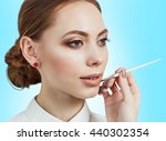 visagiste applying lipstick on... | Shutterstock . vector #440302354