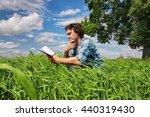 man travel in field summer | Shutterstock . vector #440319430
