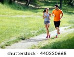beautiful couple jogging in... | Shutterstock . vector #440330668