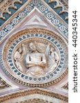 Small photo of FLORENCE, ITALY - JUNE 05: Wrapping Christ in his shroud, Portal on the side-wall of Cattedrale di Santa Maria del Fiore (Cathedral of Saint Mary of the Flower), Florence, Italy on June 05, 2015