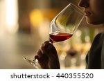woman sniffing red wine in a... | Shutterstock . vector #440355520