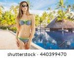 blonde girl in striped bikini | Shutterstock . vector #440399470