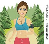 young woman jogging in forest... | Shutterstock .eps vector #440401918
