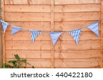 String of blue flags on fence panel