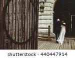 Groom Hugs Bride's Shoulder...