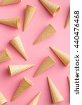 sweet wafer cones on pink... | Shutterstock . vector #440476468