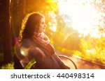 side view seated woman on the... | Shutterstock . vector #440498314
