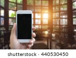 man's hand shows mobile... | Shutterstock . vector #440530450