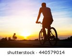 silhouette men cycling on road... | Shutterstock . vector #440579014