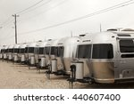 Small photo of AUSTIN, USA - APR 11, 2016: Row of new luxury american Airstream trailers at a dealership in Texas, United States