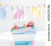 newborn baby on a pile of clean ... | Shutterstock . vector #440629186