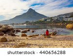 a female tourist sits on a rock ... | Shutterstock . vector #440656288